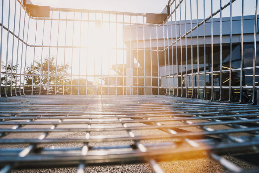 view from a shopping cart with sunlight City Cityscape Copy Space Grid Shopping Sunlight Supermarket Communication Empty Grill Metallic No People Shopping Basket Shopping Venture Summer Sunrise Sunset Sunshine