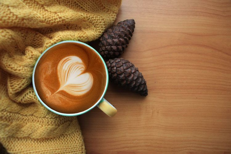 a cup of hot latte Food And Drink Cup Mug Coffee Drink Coffee - Drink Coffee Cup Refreshment Still Life Indoors  Hot Drink Table Food Freshness Cappuccino High Angle View Frothy Drink Froth Art No People Close-up Crockery Latte Breakfast Non-alcoholic Beverage Caffeine