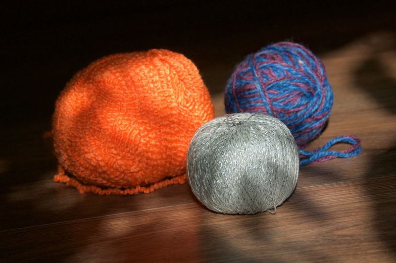 Blue Color Balls Grey Light Light And Shadow No People Red Still Life Table Wooden Wool Wool Balls