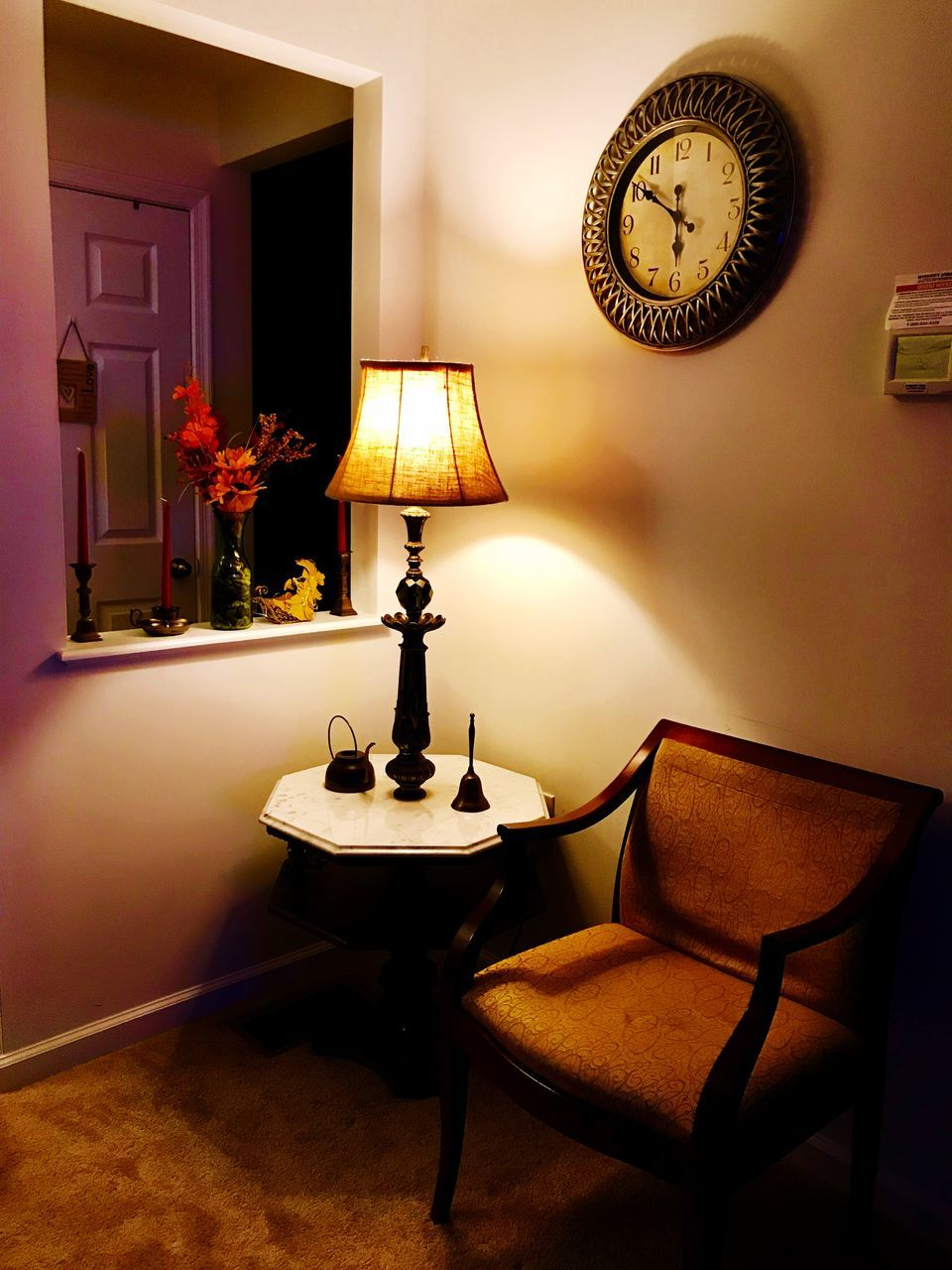 lighting equipment, illuminated, indoors, table, electric lamp, seat, no people, domestic room, home interior, chair, furniture, home, lamp shade, light, absence, clock, side table, home showcase interior, electric light, wall - building feature, luxury
