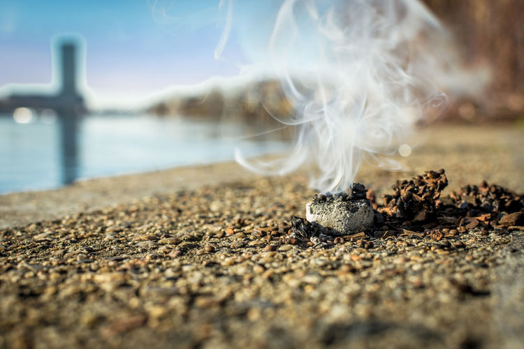 Nature No People Day Outdoors Smoke - Physical Structure Selective Focus Solid Motion Close-up Water Rock Land Social Issues RISK Burning Sky Wood - Material Rock - Object Sea Beach