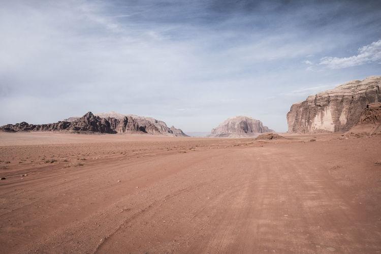 View of dirt road in desert
