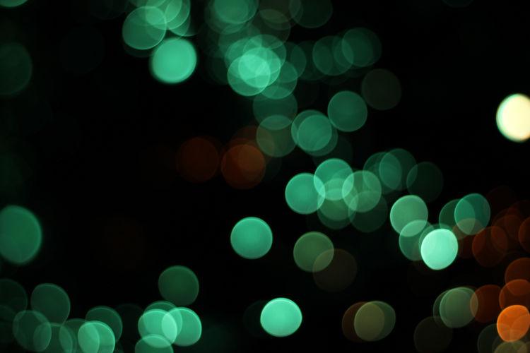 Defocused image of illuminated green lights