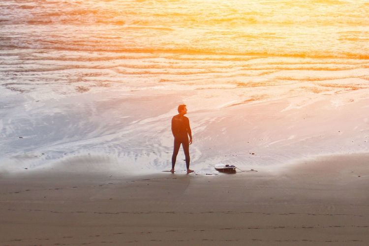 Beach Sand Full Length Healthy Lifestyle Only Men One Person Sunset Rear View Vacations One Man Only Outdoors Silhouette Sunshine Sunset_collection Adults Only Nature People Men Wave Young Adult Colorful Sport Nature Landscape Traveling