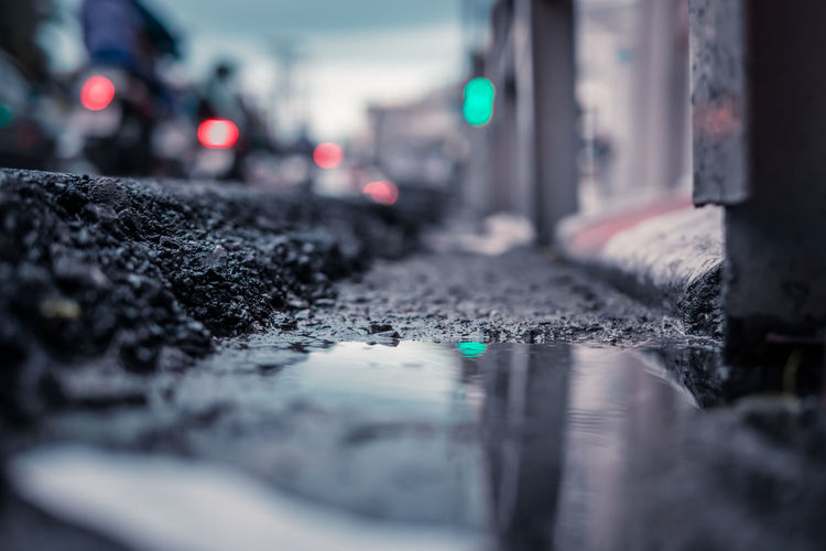 Surface level of wet road in city