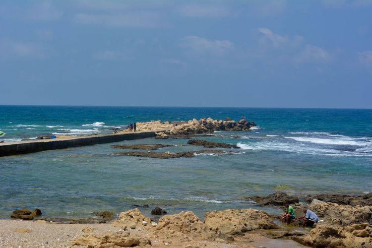 Beach Beauty In Nature Blue Day Fishing Horizon Over Water Idyllic Incidental People Lebanon Men Nature Outdoors People Rock - Object Sand Scenics Sea Shore Sky Tranquil Scene Tranquility Tyre Vacations Water
