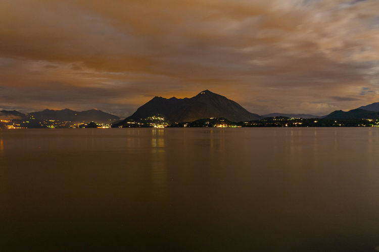 Night landscape of lake maggiore at sunset, piemonte, italy
