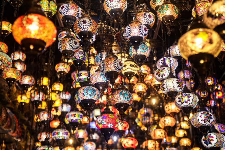 Low angle view of illuminated lanterns in store for sale at market stall
