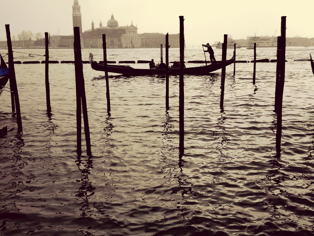 water, wooden post, no people, outdoors, day, gondola - traditional boat, nautical vessel, built structure, sea, nature, beauty in nature