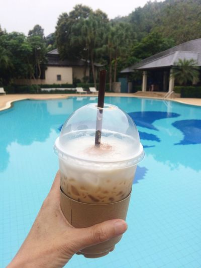 Holding Swimming Pool Food And Drink Drink Refreshment Human Hand One Person Water Outdoors Leisure Activity Day Drinking Straw Human Body Part Tree Sky Drinking Glass Freshness Women Close-up People
