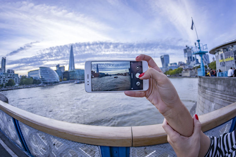Tower Bridge [Samyang 8mm f/2.8 UMC Fish-eye II] Human Hand Hand Photography Themes Technology Photographing Holding One Person Real People Activity Human Body Part Architecture Lifestyles Sky Communication Leisure Activity Built Structure Camera - Photographic Equipment City Smart Phone Wireless Technology Outdoors Finger Digital Camera London Tower Bridge