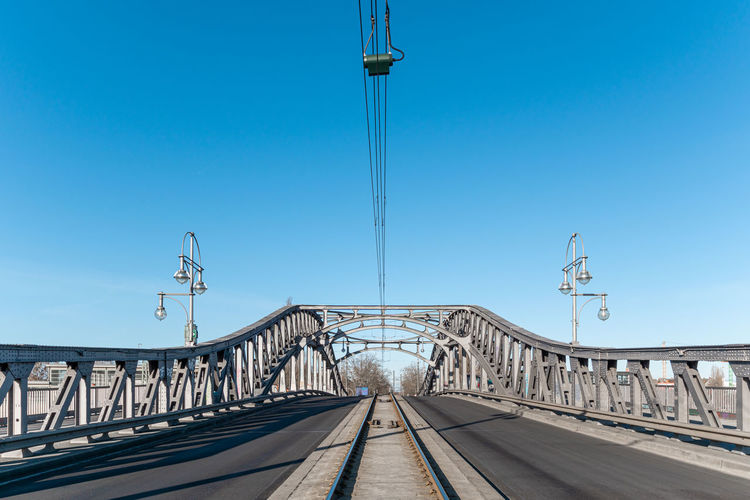 Railway bridge against clear blue sky