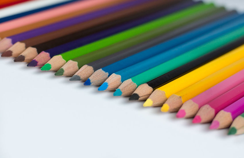 Colored pencils laid down in a row Colors Creativity Pencils Colored Pencils Colouring Pencils Discipline Stationery Uniformity