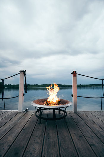Adventure Architecture BBQ Beauty In Nature Boat Boat Deck Bonfire Burning Cloud - Sky Day Evening Flame Heat - Temperature Horizon Over Water Nature No People Outdoors Relax Scenics Sea Sky Vacation Water Wood - Material