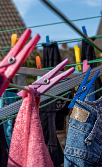 Close-up of clothespins hanging on clothesline at market