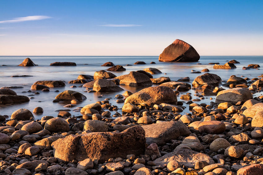 Baltic Sea coast on the island Ruegen, Germany. Baltic Sea Beach Beauty In Nature Boulders Day Foundling Holiday Horizon Over Water Lohme Nature No People Outdoors Rock - Object Ruegen Schwanenstein Sea Sky Stones Sunlight Tourism Tranquil Scene Travel Vacation Water