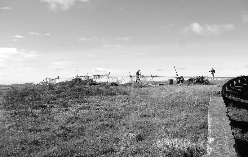 Fishing Nets ~ Azores Blackandwhite Blackandwhite Photography Day Field Fish Traps Floats Grass Growth Landscape Live For The Story Men Men At Work  Nature Nylon Outdoors Sky The Great Outdoors - 2017 EyeEm Awards The Street Photographer - 2017 EyeEm Awards