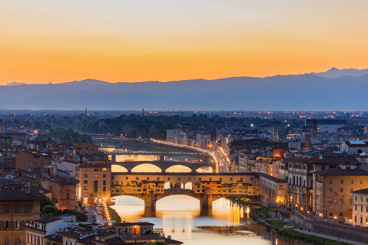 Ponte vecchio bridge in silhouette in florence at sunset