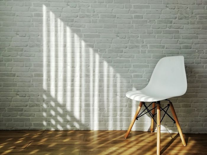 Shadow Chair Hardwood Floor Brick Wall Window Wall - Building Feature Whitewashed Blinds Worn Out Armchair Furniture Outdoor Cafe Empty Room Floor Lamp Discarded Decline Penthouse Coffee Table Peeled Daylight Open Door Lamp Shade  Holiday Villa Orthodox Church Parquet Floor Interior Absence Wall White Line