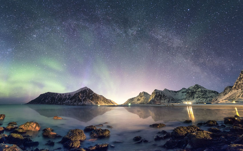 Panorama of Aurora borealis with Milky way galaxy over snow mountain in coastline at Skagsanden beach, Lofoten, Norway Snowcapped Mountain Mountain Peak Mountain Range Milky Way Nature Snow No People Cold Temperature Idyllic Tranquil Scene Tranquility Star - Space Space Mountain Water Astronomy Scenics - Nature Beauty In Nature Sky Night Galaxy Lake Skagsanden Beach Aurora Borealis