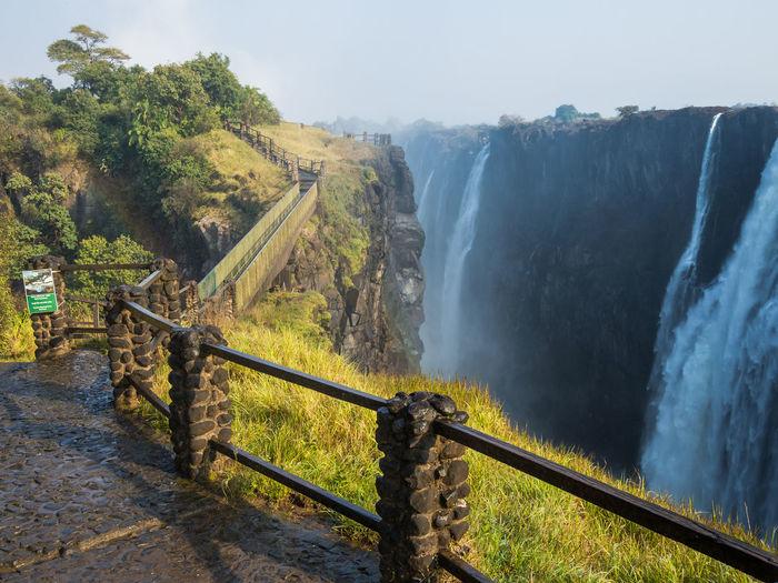 Scenic View Of Foot Path And Bridge At Victoria Falls