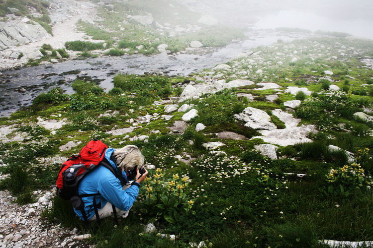 Brook Camera - Photographic Equipment Grass Plants Tatra Mountains Tatry The Week On EyeEm Adult Adventure Backpack Beauty In Nature Fog Hiker Hiking Leisure Activity Mist Mountain Mountain Range Mountain Stream Mountains Nature Outdoors Photographer Rock - Object Water Go Higher