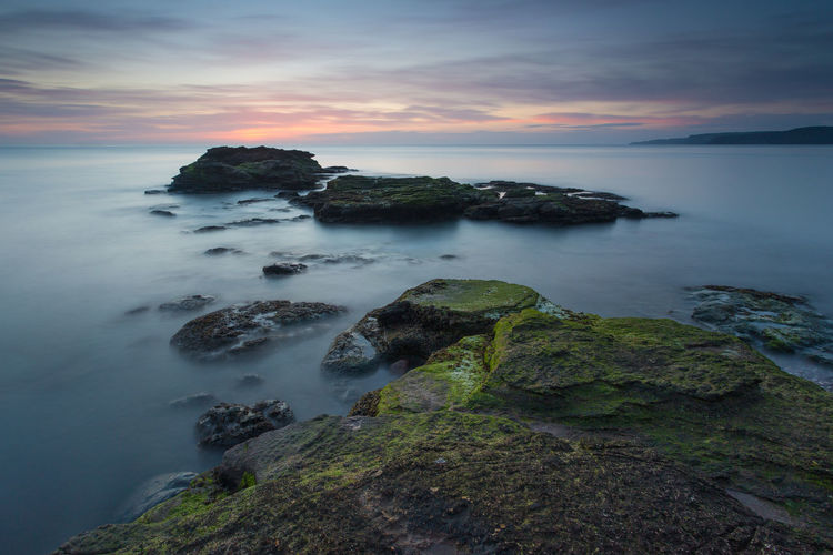 The tide was very high here which isolated the rocks like stepping stones Bay Beauty In Nature Cloud - Sky Colour Cornelian Day Green Growth High Tide Horizon Over Water Nature No People Outdoors Rock - Object Rocks Scenics Sea Seascape Sky Sunrise Sunset Tranquil Scene Tranquility Water