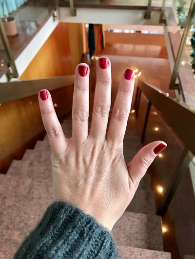 Hand with nail polish Red Nail Polish Nailpolish Real People One Person Human Hand Human Body Part Personal Perspective Indoors  Leisure Activity Women Low Section Lifestyles Close-up Adult People