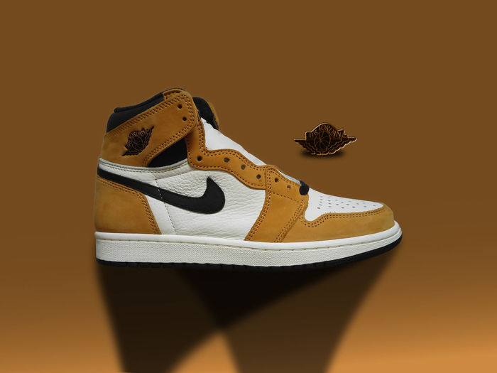 """Nike Air Jordan """"Rookie of the year"""" Studio Shot Colored Background Indoors  Still Life No People Shoe Wood - Material Brown Close-up Animal Representation Representation Pair Single Object Animal Copy Space Animal Themes Yellow Cut Out Mammal Art And Craft Air Jordan Rookie Of The Year"""