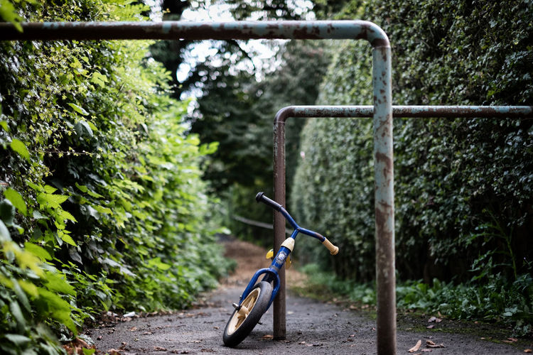 Bicycle on footpath by railing