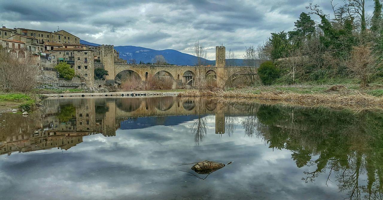 Bridge Of Besalu Against Cloudy Sky