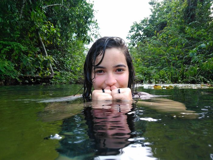 Portrait of teenage girl swimming in lake