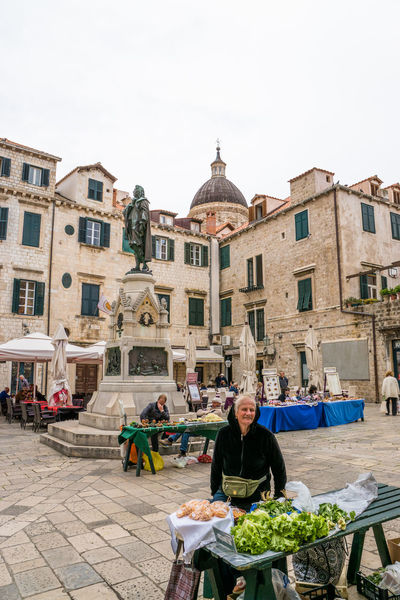 Dubrovnik Architecture Built Structure Casual Clothing City City Life Day Dubrovnik Leisure Activity Lifestyles One Outdoors Sitting Sky Street Street Vendor Tourism Travel Destinations Vegetables Feel The Journey