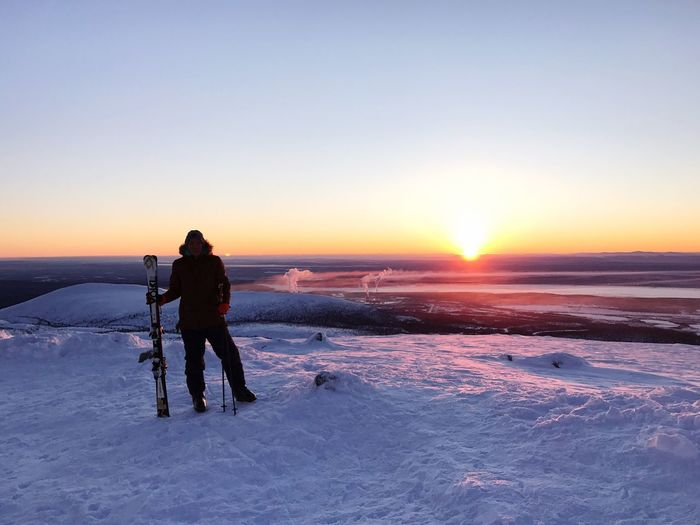 Winter Sunset Snow Cold Temperature Beauty In Nature Nature Scenics Clear Sky One Person Leisure Activity Full Length Sun Lifestyles Sky Outdoors Warm Clothing Real People Tranquil Scene Men Day хибины Mountain Frozen Clear Sky Beauty In Nature Be. Ready.