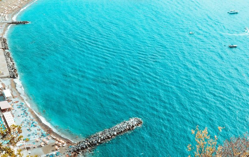 Top View Aerial View Drone View View View From Above Viewpoint Water UnderSea Sea Beach Blue Aerial View High Angle View Turquoise Shore Rushing Sandy Beach Sand Coastline Hooded Beach Chair Ocean Calm Idyllic Turquoise Colored Coast Wave Clear Pebble Beach Surf Seascape