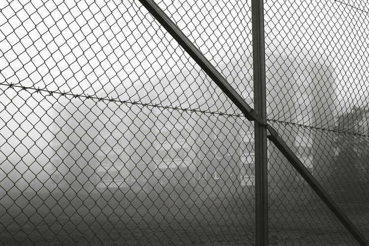 Fenced suburb Metal No People Fence Chainlink Fence Pattern Full Frame Protection Security Boundary Barrier Safety Architecture Backgrounds Day Built Structure Outdoors Wire Mesh Nature Close-up Connection Alloy Steel Apartment Buildings Foggy November