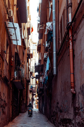View of narrow street between old residential building