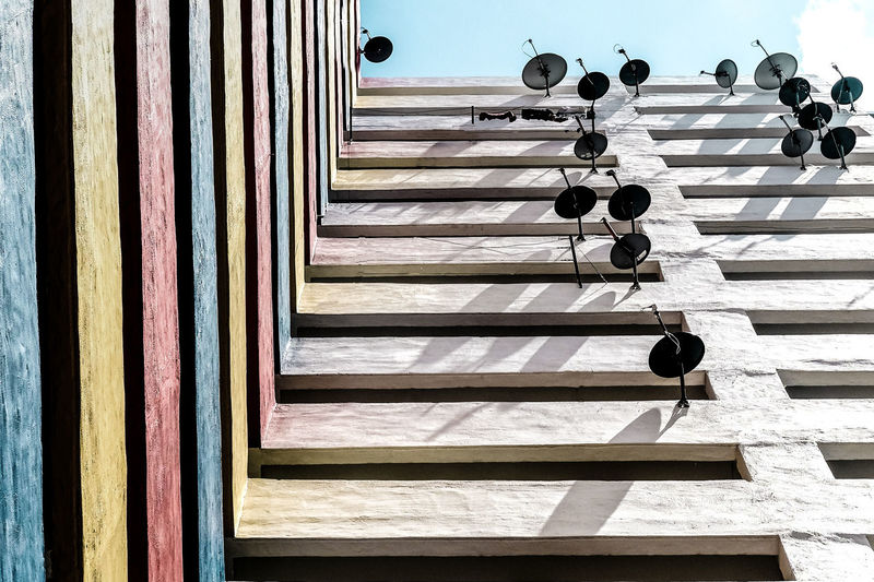Urban Jungle - Stacked Connections Highrise Apartments The Architect - 2018 EyeEm Awards Architecture Building Exterior Built Structure Connections Day In A Row Low Angle View Multi Colored No People Pattern Satellite Dishes Shadow Stacked Sunlight