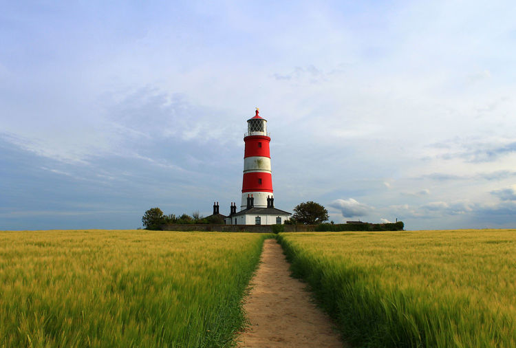 View of lighthouse on field