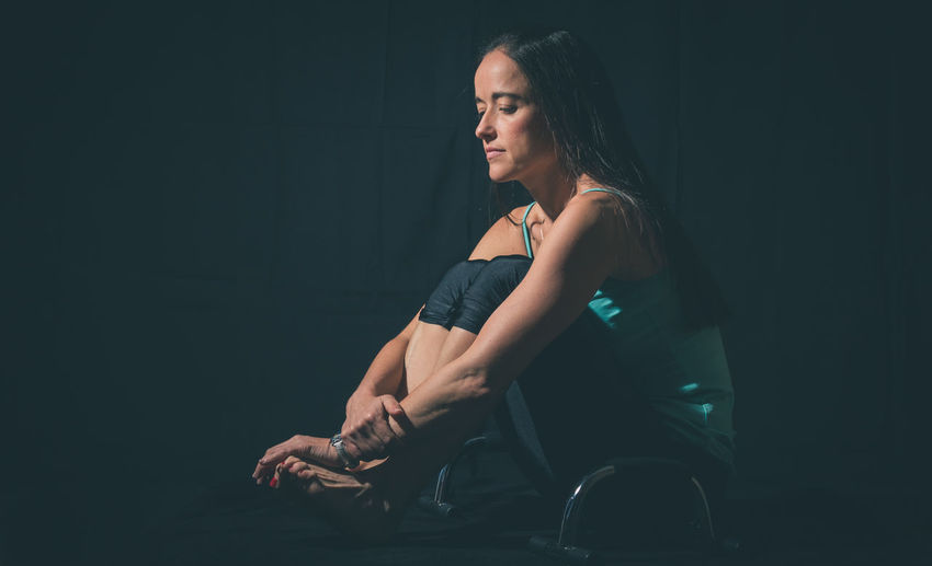 Beautiful Black Background Studio Woman Black Background Casual Clothing Contemplation Copy Space Depressed Full Length Indoors  Lifestyles Looking Looking Away One Person Portrait Real People Sad Serious Sitting Women Young Adult