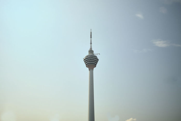 Low angle view of kl tower against sky