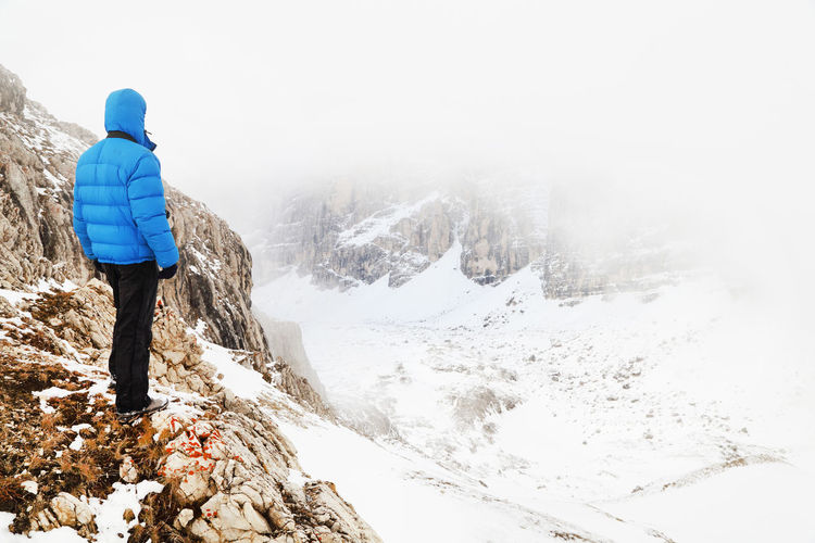 Rear View Of Man On Snow Covered Mountain