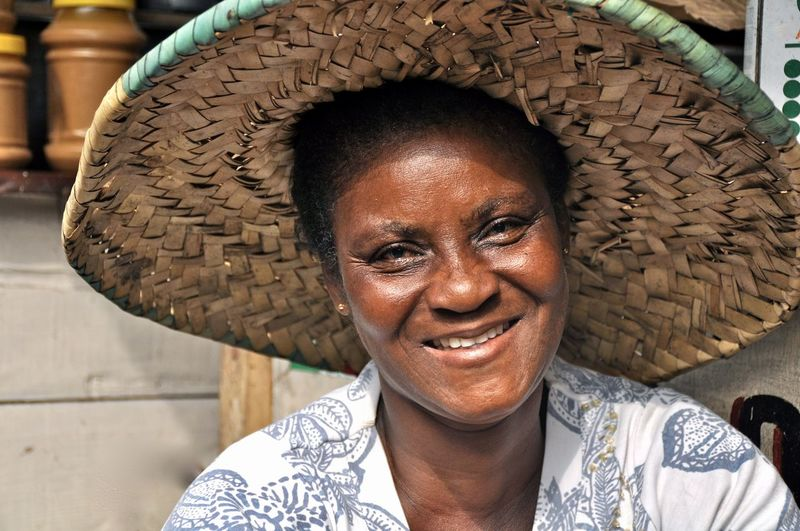 Close-up portrait of smiling mature woman wearing straw hat