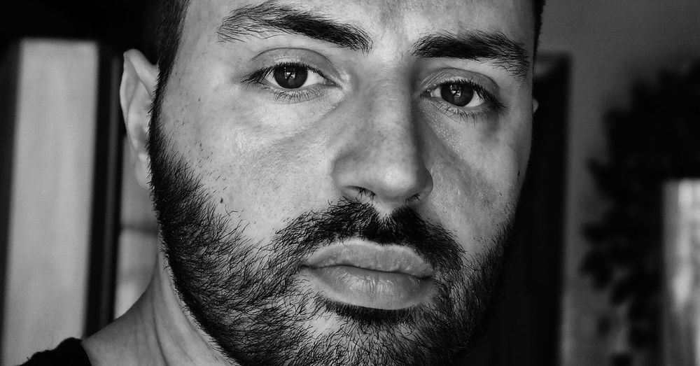 Close-Up Portrait Of Serious Man