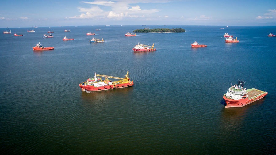 Aerial view of offshore support vessels in Labuan,Malaysia.More vessel repair jobs to Labuan now as the outlook of the oil & gas sector in the island has improved. Water Nautical Vessel Sea Transportation Mode Of Transportation Waterfront Ship Freight Transportation Day Sky Business Shipping  Industry Scenics - Nature Travel Outdoors Vessels Oil And Gas Exploration Maritime Offshore Technology Tugboat Shipping  Petroleum