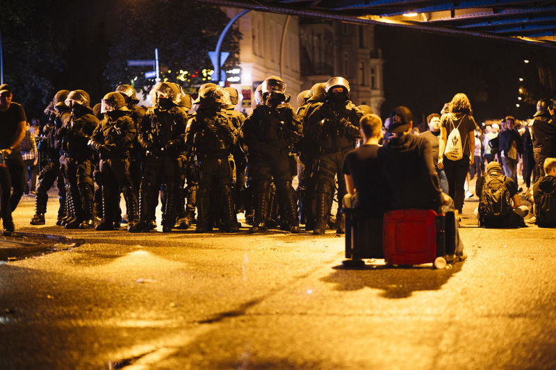 G20 Summit Polizei City Crowd Group Of People Helmet Helmets Illuminated Large Group Of People Night Police Police At Work Police Force Police Uniform Protection Real People Responsibility Standing Street Swat Uniform