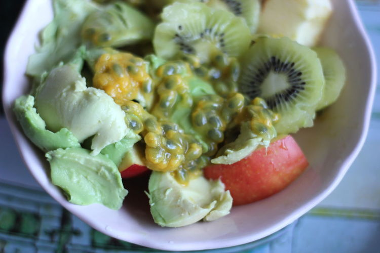Close-up of fresh fruit salad served in bowl on table