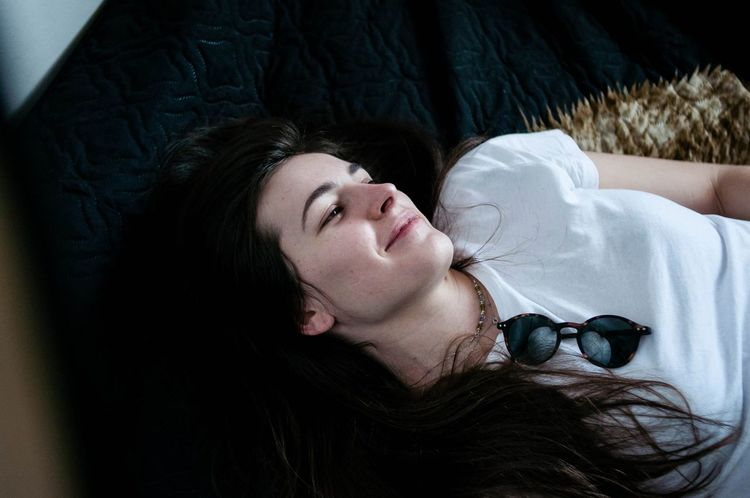 One Young Woman Only Bed Lying Down Indoors  Bedroom Portrait Beautiful Woman Beauty Black Cozy At Home Layingdown Laying In Bed Long Hair Leisure Activity Happiness Smiling