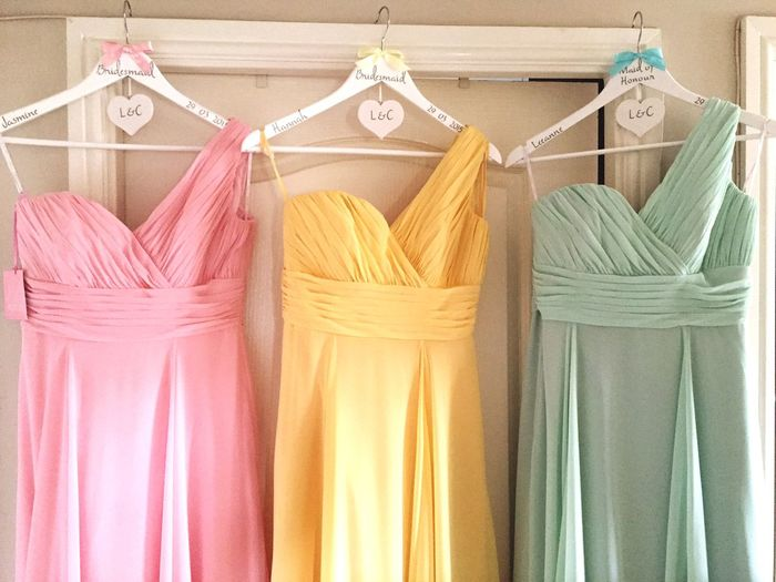 Row of bridal gowns hanging on wall
