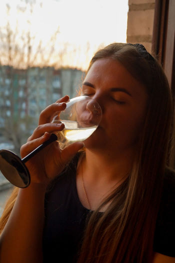Close-up of woman drinking wine